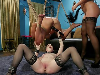 Cherie Deville abuses her slaves encircling a lesbian threesome