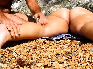 Massage unshaded pussy and ass readily obtainable beach