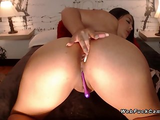 Busty with hot lips sucks dildo in excess of cam