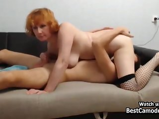 Horny Redhead Cougar Fucks Young Impoverish On Couch