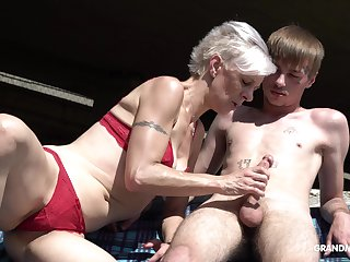 Kinky granny fro ties sucks a fat hard penis of one young guy