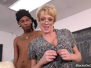 Busty blonde teacher, Alura and her assistant, Dee are having interracial threesome in the classroom