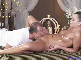 Gentle going to bed during a massage for charming brunette Erica Black