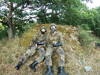 Two Put the squeeze on someone In German Flecktarn Are Wanking In The Forrest