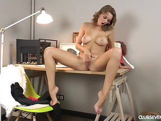 Busty glamour babe using a big vibrator