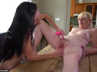 Cougar Broad And Pretty Woman Masturbating Almost Dildo On The Desk